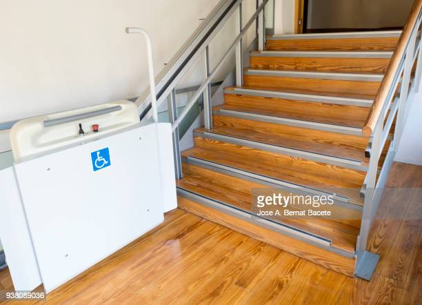 elevator to raise stairs you persons with wheelchair, stairlift for the disabled. - elevador de escada imagens e fotografias de stock