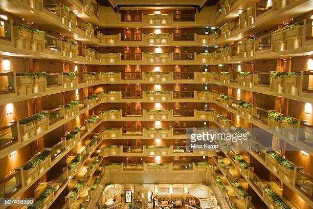 Elevators and balconies in the atrium at Hong Kongs famous Royal Garden Hotel Situated on the Kowloon side of Hong Kong Harbour this architectural...