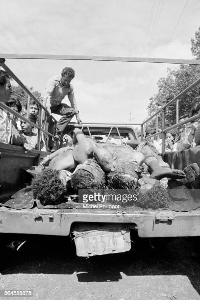 Eleven bodies of Marxist guerillas killed by right-wing forces are taken to the hospital morgue during the civil war that ravaged El Salvador between...
