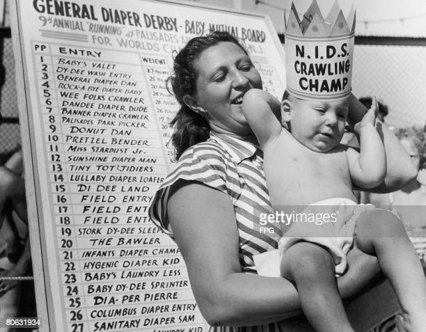 Eleven month old Peter Ruttenberg with his mother after winning the Diaper Derby at the Palisades Amusement Park New Jersey 1947