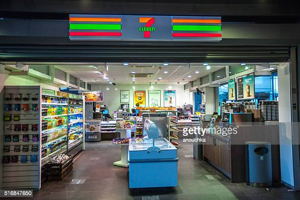 7 eleven store at oslo train station, norway - convenience store stock photos and pictures