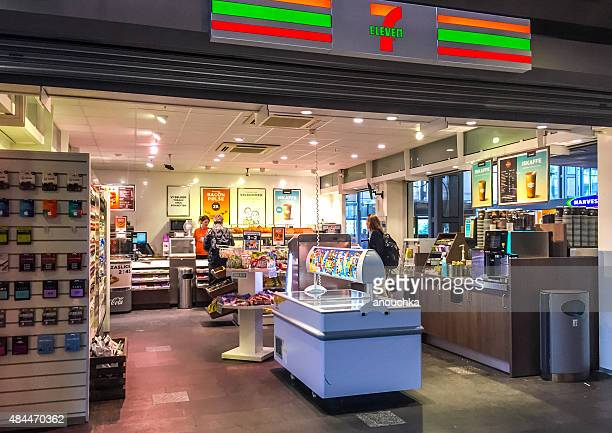 7 eleven store inside oslo central train station, norway - convenience store stock photos and pictures