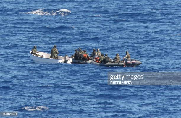 Eleven suspected pirates are taken to the French warship 'The Nivose' after their capture on two skiffs on which were found two assault rifles a...