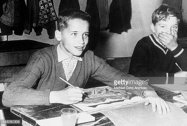 Eleven year old Arnold Schwarzenegger poses for a photo in art class in 1958 in Thal Austria