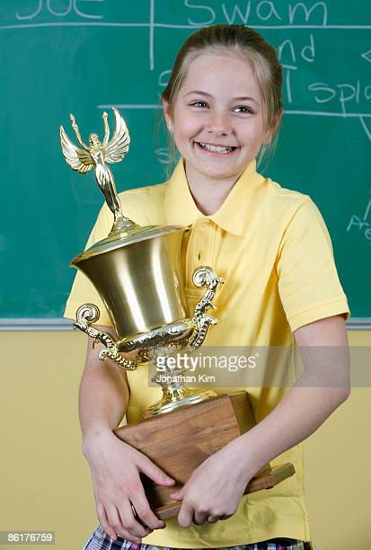eleven year old girl with trophy.  - holding trophy stock pictures, royalty-free photos & images