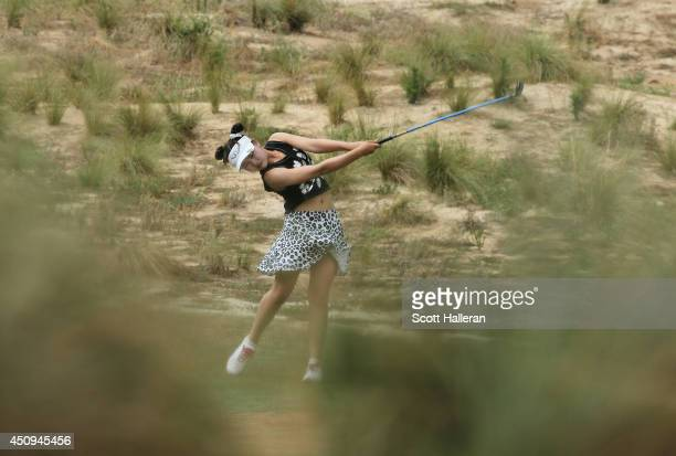Eleven yearold amateur Lucy Li of the United States hits her second shot on the eighth hole during the second round of the 69th US Women's Open at...