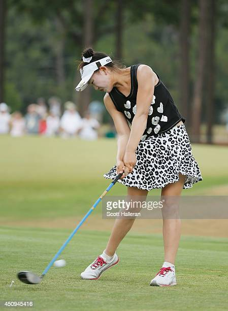 Eleven yearold amateur Lucy Li of the United States hits her tee shot on the eighth hole during the second round of the 69th US Women's Open at...