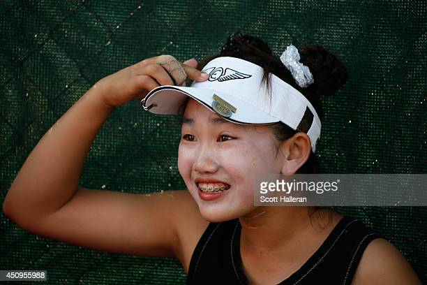 Eleven yearold amateur Lucy Li of the United States speaks to members of the media during the second round of the 69th US Women's Open at Pinehurst...