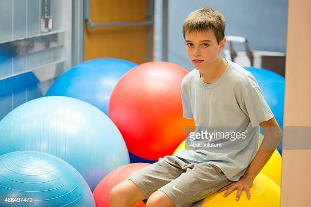 Eleven Years Old Boy among Fitness Balls, School Gymnasium, Europe