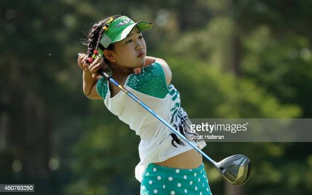 Elevenyear old Amateur Lucy Li of the United States hits a shot during a practice round prior to the start of the 69th US Women's Open at Pinehurst...