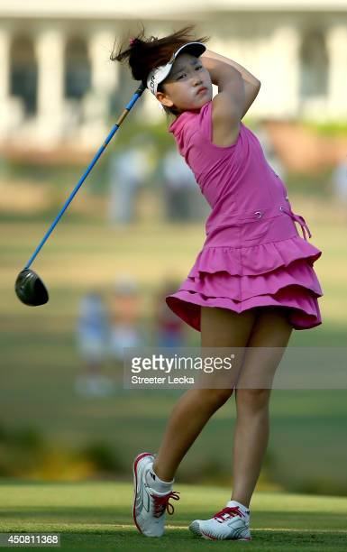 Elevenyear old Amateur Lucy Li of the United States hits a tee shot during a practice round prior to the start of the 69th US Women's Open at...