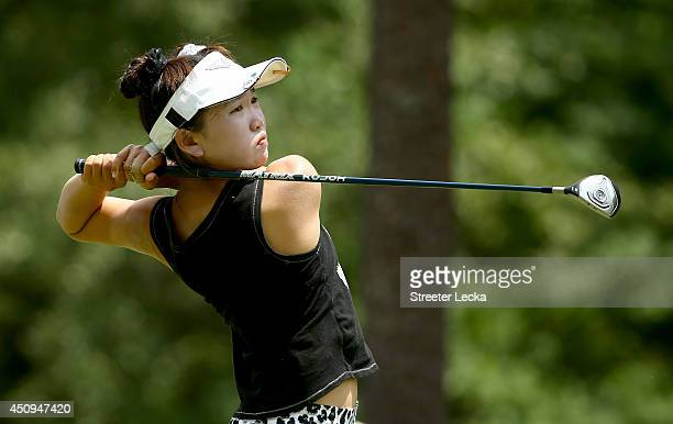 Elevenyear old Amateur Lucy Li of the United States hits a tee shot on the sixth hole during the second round of the 69th US Women's Open at...