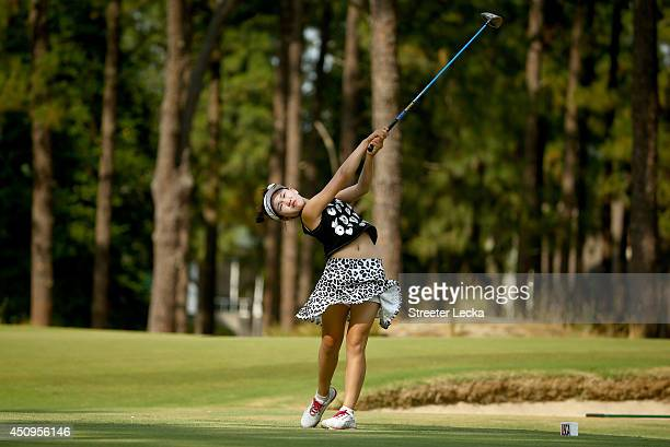 Elevenyear old Amateur Lucy Li of the United States hits a tee shot on the 18th hole during the second round of the 69th US Women's Open at Pinehurst...