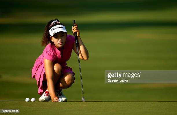 Elevenyear old Amateur Lucy Li of the United States lines up a putt during a practice round prior to the start of the 69th US Women's Open at...