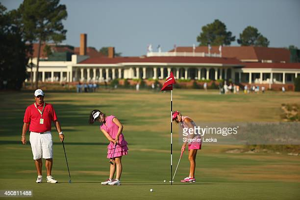 Elevenyear old Amateur Lucy Li of the United States practices alongside Lexi Thompson of the United States during a practice round prior to the start...