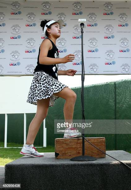 Elevenyear old Amateur Lucy Li of the United States speaks to the media after the second round of the 69th US Women's Open at Pinehurst Resort...