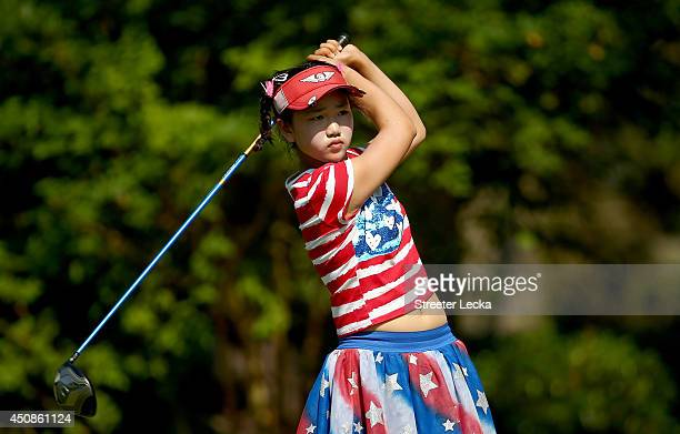 Elevenyear old Amateur Lucy Li of the United States takes a practice swing on the third hole during the first round of the 69th US Women's Open at...