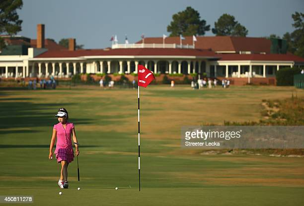 Elevenyear old Amateur Lucy Li of the United States walks on the first green during a practice round prior to the start of the 69th US Women's Open...