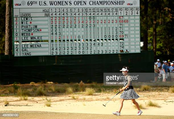 Elevenyear old Amateur Lucy Li of the United States walks up the 18th fairway during the second round of the 69th US Women's Open at Pinehurst Resort...