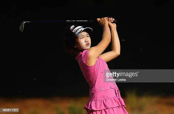 Elevenyear old Amateur Lucy Li of the United States watches a shot during a practice round prior to the start of the 69th US Women's Open at...