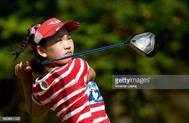 Elevenyear old Amateur Lucy Li of the United States watches a tee shot on the third hole during the first round of the 69th US Women's Open at...