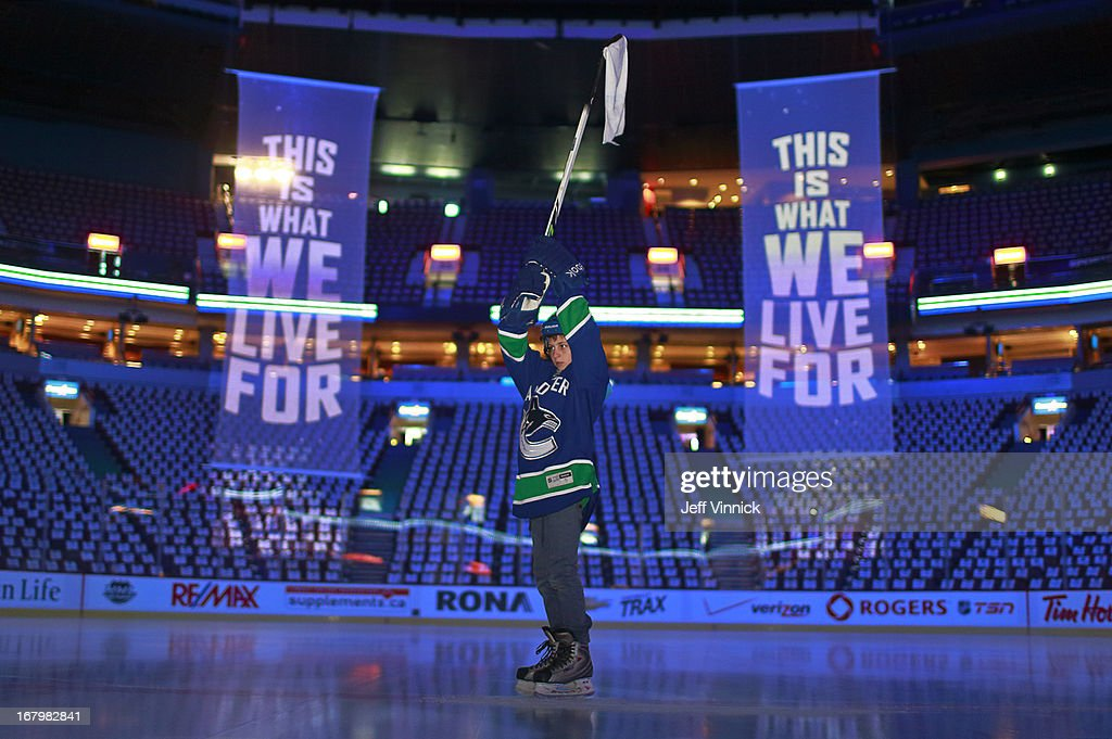 Eleven-year-old Ben Vinnick stands at centre ice as he rehearses for the game opening before Game Two of the Western Conference Quarterfinals between the San Jose Sharks and the Vancouver Canucks during the 2013 NHL Stanley Cup Playoffs at Rogers Arena on May 3, 2013 in Vancouver, British Columbia, Canada.