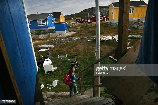 Elevenyearold Inuit fisherman's daughter Caria Rosbach heads for school August 27 2007 in her home village of Ilimanaq Greenland Her father Arne...