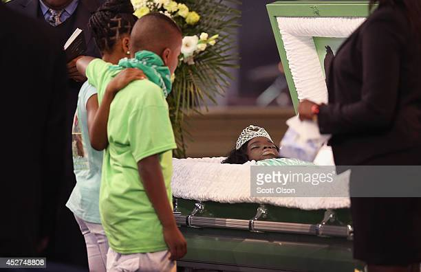 Elevenyearold Jeremiah Adams views the remains of his twin sister Shamiya during a wake at Living Word Christian Center on July 26 2014 in Forest...