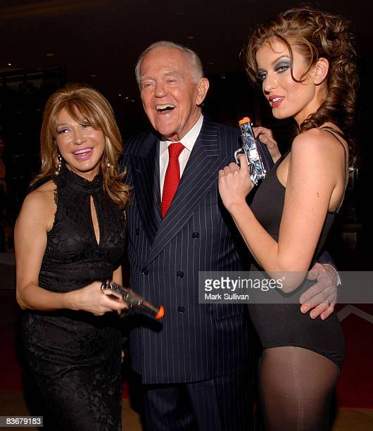 Elezabeth Segerstrom and Henry Segerstrom of South Coast Plaza with model at the OMEGA and Tourbillon Great Moments in Time with James Bond event...