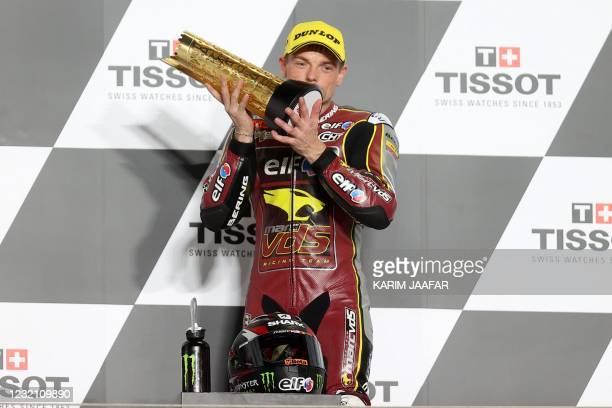 Elf Marc VDS Racing Team's British rider Sam Lowes celebrates with the trophy after winning the Moto2 Grand Prix of Doha at the Losail International...