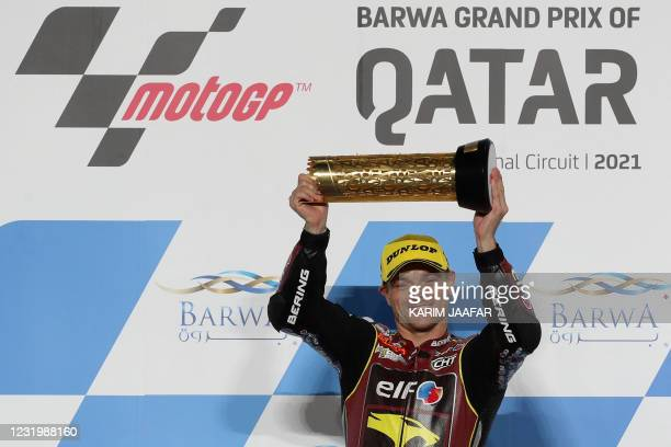 Elf Marc VDS Racing Team's British rider Sam Lowes poses with the trophy after winning the Moto2 GP Qatar Grand Prix at the Losail International...