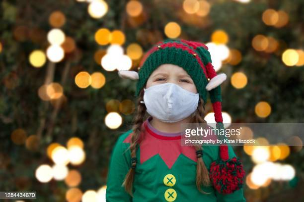 elf wearing a face mask with christmas lights - christmas stock pictures, royalty-free photos & images