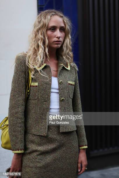 Elfie Reigate is seen wearing a Tweed Suit at Richard Quinn during London Fashion Week September 2021 on September 21, 2021 in London, England.