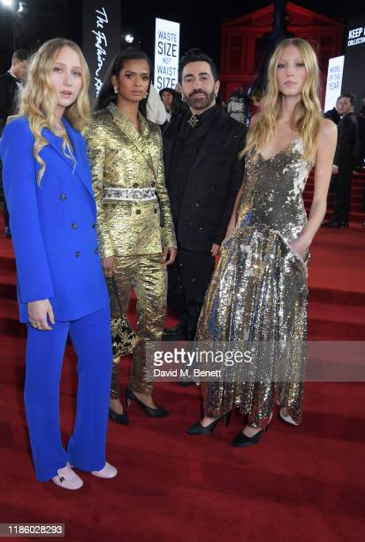 Elfie Reigate Ramla Ali Mulberry Creative Director Johnny Coca and Ella Richards arrive at The Fashion Awards 2019 held at Royal Albert Hall on...