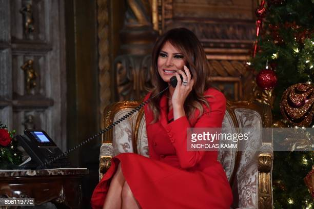 elFirst Lady Melania Trump participates in NORAD Santa Tracker phone calls at the MaraLago resort in Palm Beach Florida on December 24 2017 NORAD...
