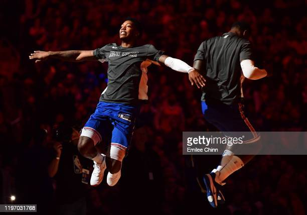 Elfrid Payton and Julius Randle of the New York Knicks jump to high five prior to their game against the Portland Trail Blazers at Madison Square...