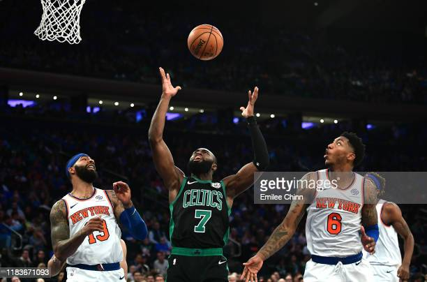 Elfrid Payton and Marcus Morris Sr #13 of the New York Knicks watch as Jaylen Brown of the Boston Celtics catches the rebound during the second half...