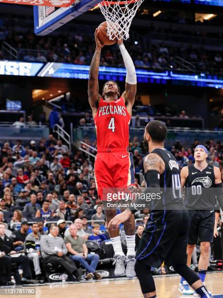 Elfrid Payton of the New Orlean Pelicans goes up for a dunk over DJ Augustin of the Orlando Magic at the Amway Center on March 20 2019 in Orlando...
