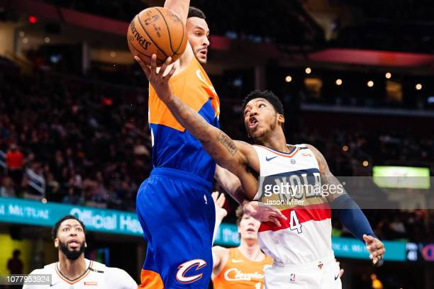 Elfrid Payton of the New Orleans Pelicans shoots around Larry Nance Jr #22 of the Cleveland Cavaliers during the first half at Quicken Loans Arena on...