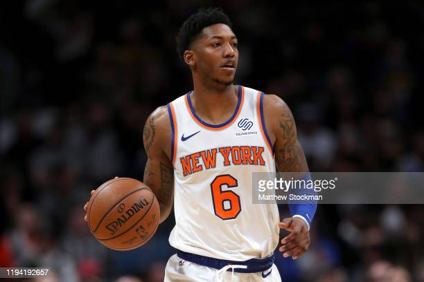 Elfrid Payton of the New York Knicks brings the ball down the court against the Denver Nuggets in the first quarter at the Pepsi Center on December...
