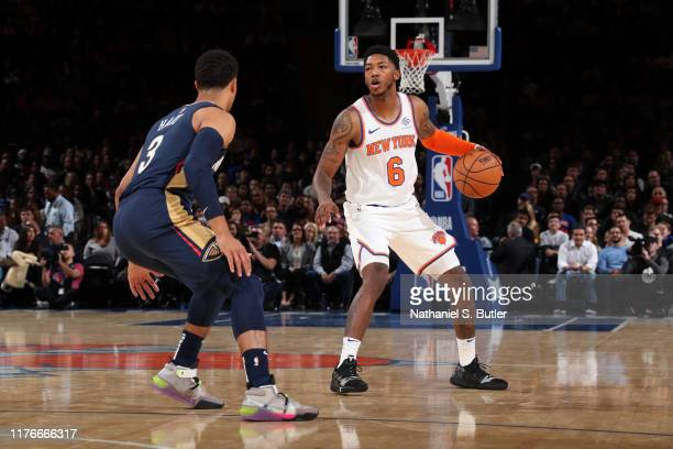 Elfrid Payton of the New York Knicks handles the ball against the New Orleans Pelicans during a pre-season game on October 18, 2019 at Madison Square...