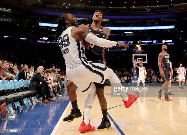 Elfrid Payton of the New York Knicks shoves Jae Crowder of the Memphis Grizzlies after he attempted a three point shot in the final minutes of the...