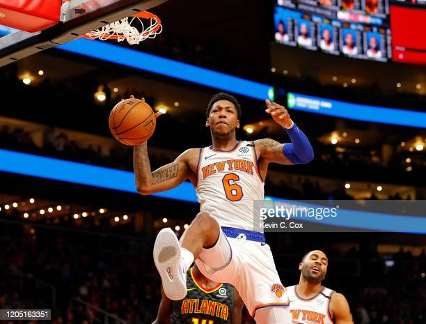 Elfrid Payton of the New York Knicks slaps the ball after dunking against the Atlanta Hawks in the first half at State Farm Arena on February 09,...