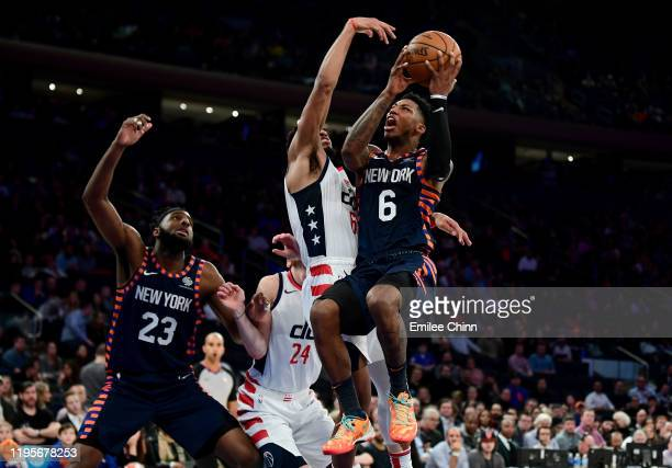 Elfrid Payton of the New York Knicks takes a shot past Troy Brown Jr #6 of the Washington Wizards during the second half of their game at Madison...
