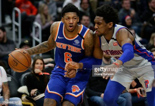 Elfrid Payton of the New York Knicks tries to drive against Langston Galloway of the Detroit Pistons during the first half at Little Caesars Arena on...