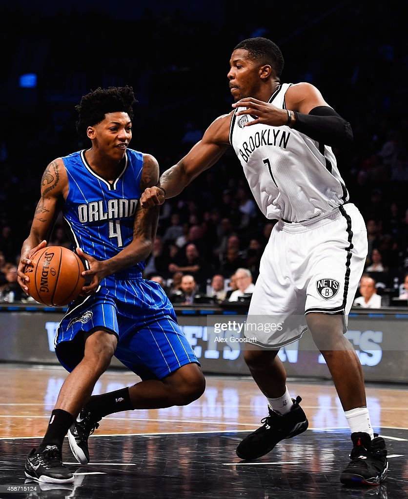 Elfrid Payton #4 of the Orlando Magic attempts to dribble around Joe Johnson #7 of the Brooklyn Nets in the first half at the Barclays Center on November 9, 2014 in the Brooklyn borough of New York City.
