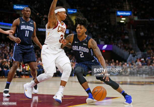 Elfrid Payton of the Orlando Magic drives the lane against Isaiah Thomas of the Cleveland Cavaliers at Quicken Loans Arena on January 18 2018 in...