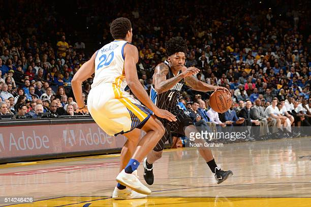Elfrid Payton of the Orlando Magic drives to the basket against James Michael McAdoo of the Golden State Warriors during the game on March 7 2016 at...