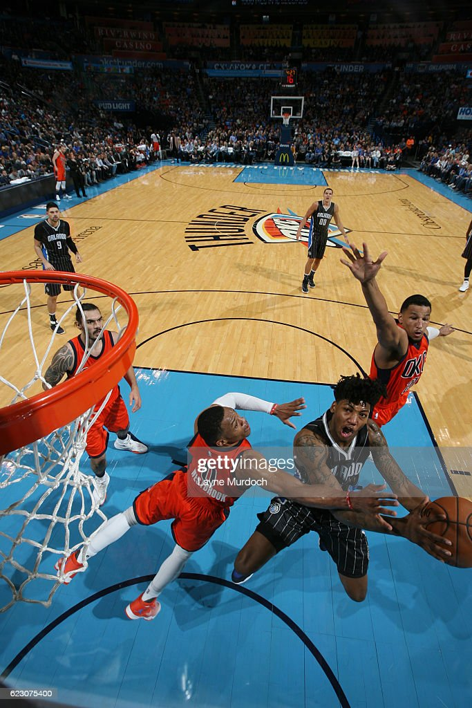 Elfrid Payton #4 of the Orlando Magic goes up for a shot against Russell Westbrook #0 of the Oklahoma City Thunder during a game on November 13, 2016 at Chesapeake Energy Arena in Oklahoma City, Oklahoma.
