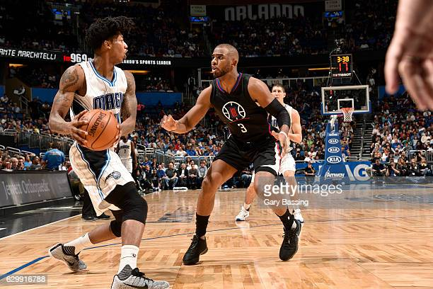Elfrid Payton of the Orlando Magic handles the ball during the game against Chris Paul of the Los Angeles Clippers on December 14 2016 at Amway...